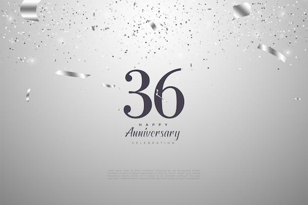 36e anniversaire avec des chiffres sur fond argenté