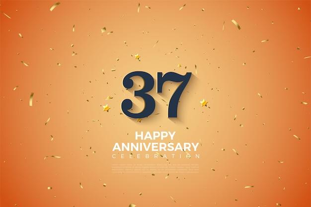 37e anniversaire sur fond orange et taches dorées