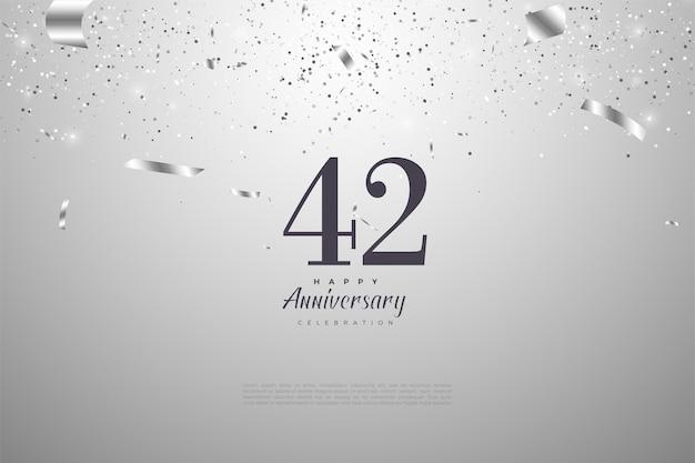42e anniversaire avec chiffres et ruban en argent