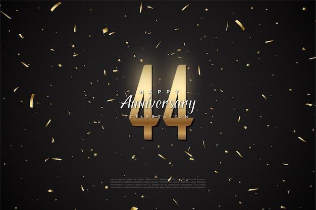 44e anniversaire avec des chiffres et des points d'or