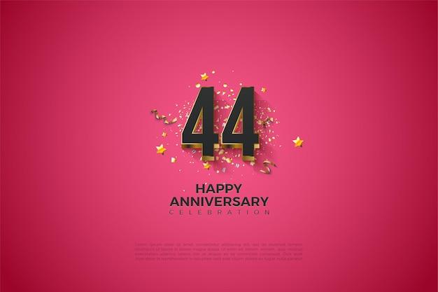 44e anniversaire avec plaqué or sur fond rose foncé