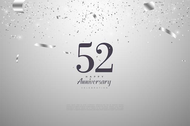 52e anniversaire avec des chiffres noirs sur fond argenté