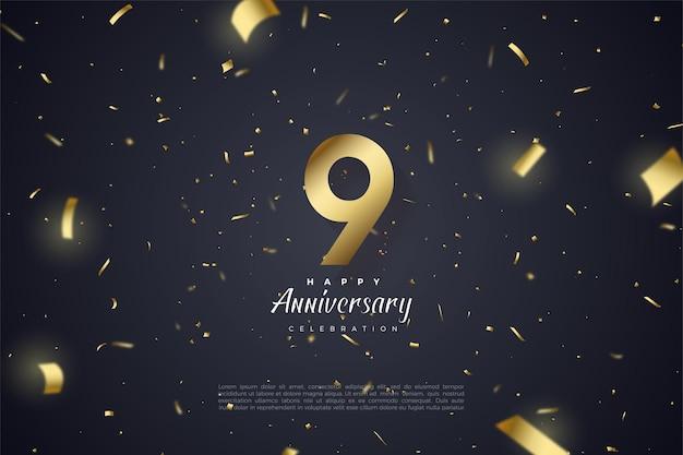 9e anniversaire avec nombre et papier d'or dispersés