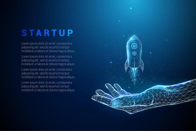 Abstrait bleu donnant la main avec lancement de fusée. conception de style low poly. structure de connexion de lumière filaire.