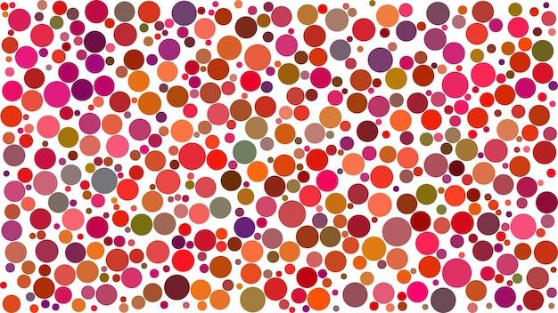 Abstrait de cercles de différentes tailles dans les tons de rouge sur fond blanc.