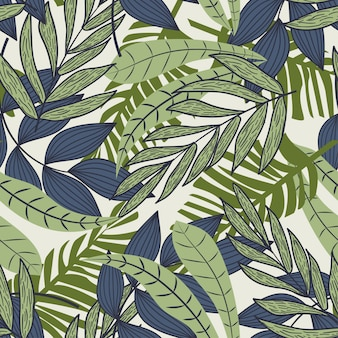 Abstrait modèle sans couture avec des feuilles tropicales colorées et des plantes sur fond beige
