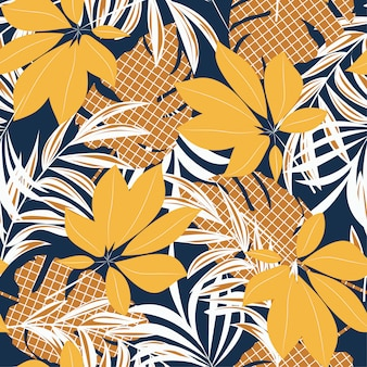 Abstrait modèle sans couture avec des feuilles tropicales colorées et des plantes sur fond bleu