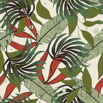 Abstrait modèle sans couture avec des feuilles tropicales colorées et des plantes sur un fond délicat