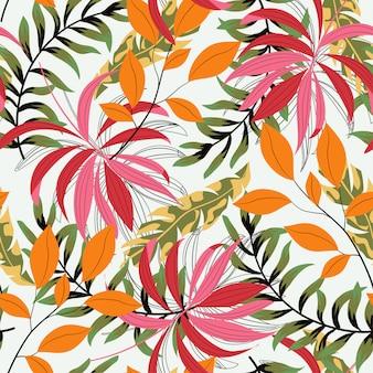 Abstrait modèle sans couture avec les plantes et les feuilles tropicales colorées