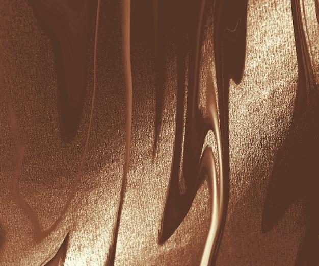 Abstrait de peinture à l'encre liquide cuivre.