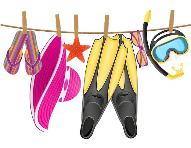 Accessoires de plage suspendus à une corde avec une pince à linge