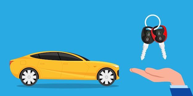 L'achat ou la location d'une voiture neuve ou d'occasion concessionnaire donnant la chaîne de clés à une main d'acheteur