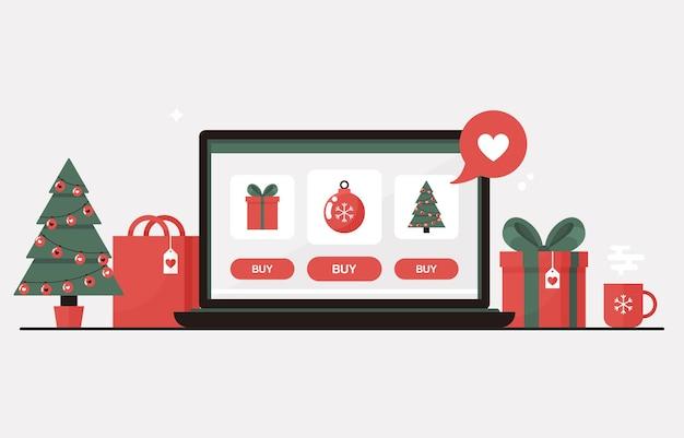 Achats en ligne de noël sur un ordinateur portable avec arbre de noël, coffrets cadeaux, cadeaux et décorations pour les soldes d'hiver