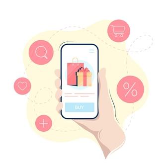 Achats en ligne sur un smartphone, main tenant un téléphone portable