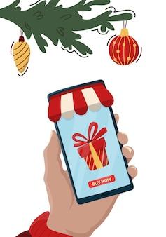 Achats de noël dans l'application mobile. énorme boîte-cadeau présente sur l'écran du smartphone.