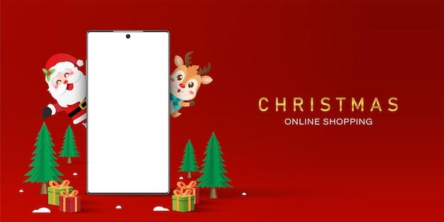 Achats de noël en ligne sur le concept de smartphone, smartphone à écran blanc avec le père noël et les rennes, joyeux noël