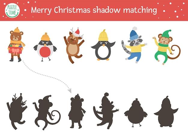 Activité d'association d'ombres de noël pour les enfants puzzle d'hiver avec des animaux mignons dans des vêtements chauds