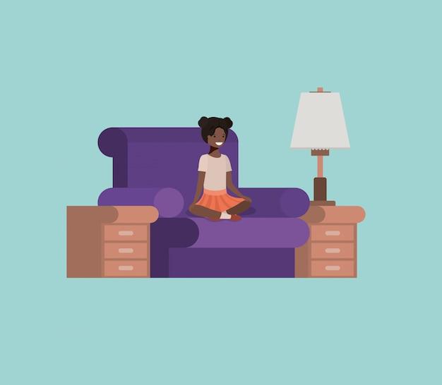 Adolescente noire assise dans le salon