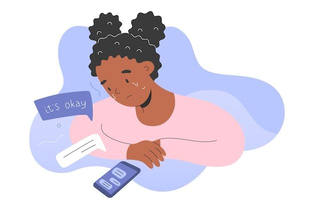 Adolescente pleure et messagerie texte avec un psychologue dans l'application pour smartphone