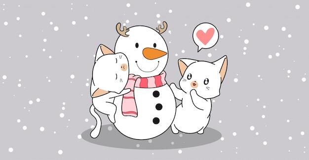 Adorable chat embrasse un bonhomme de neige
