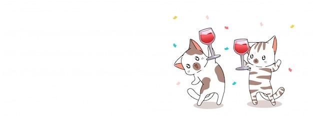Adorables chats tiennent une tasse de vin pour la célébration