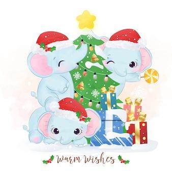 Adorables éléphants jouant avec un arbre de noël
