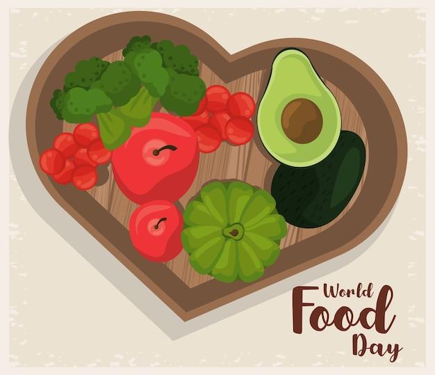 Affiche de la journée mondiale de l'alimentation avec des légumes dans la conception d'illustration de planche de coeur en bois