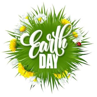 Affiche de lettrage de jour de la terre avec le titre. planète globe vert avec de l'herbe et des fleurs. eps10
