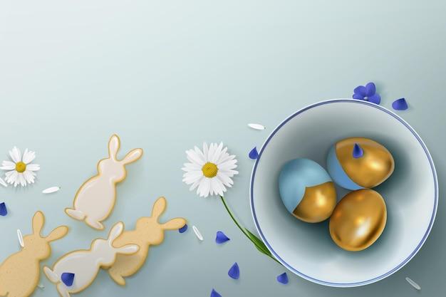 Affiche avec des oeufs d'or dans un bol en céramique avec des fleurs et des biscuits en forme de lièvres sur le fond.