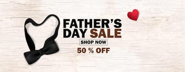 Affiche de promotion de la vente de la fête des pères ou bannière design marketing des médias sociaux avec noeud papillon noir rouge entendu sur fond en bois modèle de promotion et d'achat pour la fête des pères