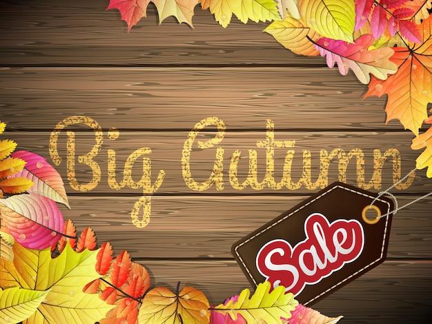 Affiche de typographie automne grande vente sur fond de bois.
