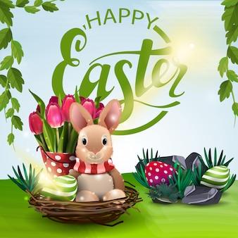 Affiche avec voeux de joyeuses pâques avec le lapin de pâques et les tulipes