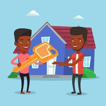Agent immobilier donnant la clé au nouveau propriétaire de la maison.