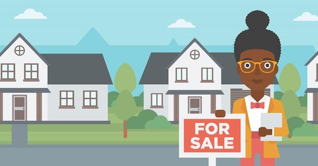 Agent immobilier offrant maison.