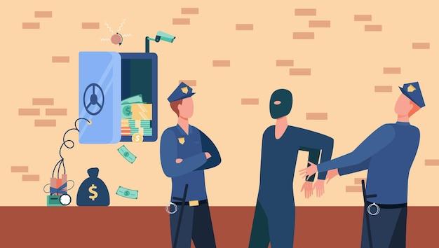 Les agents de police arrêtant l'homme voleur de coffre-fort de banque