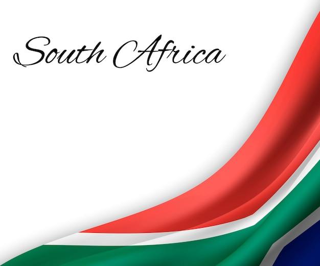 Agitant le drapeau de l'afrique du sud sur fond blanc.