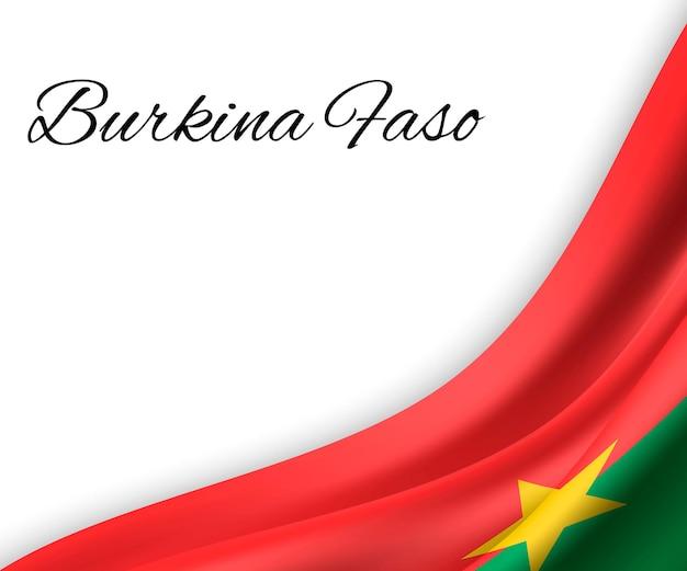 Agitant le drapeau du burkina faso sur fond blanc.