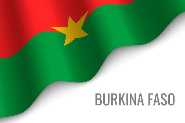 Agitant le drapeau du burkina faso