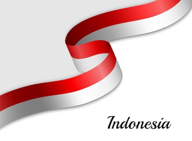 Agitant le drapeau du ruban de l'indonésie