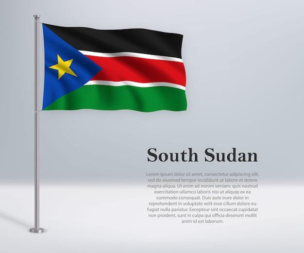 Agitant le drapeau du soudan du sud sur mât