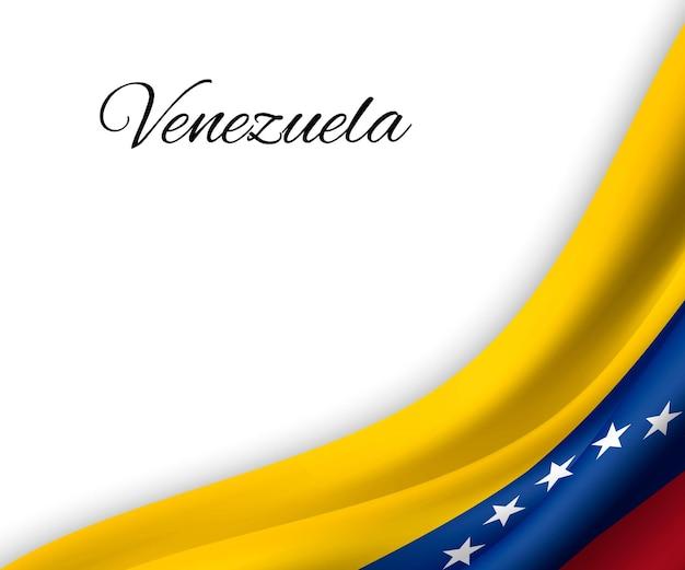 Agitant le drapeau du venezuela sur fond blanc.