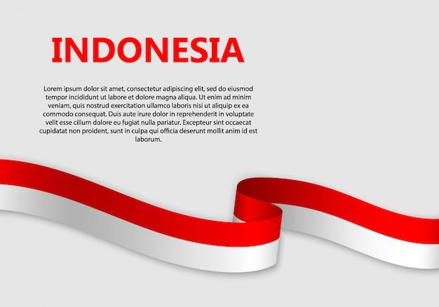Agitant le drapeau de l'indonésie