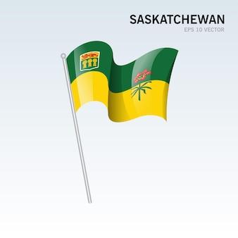 Agitant le drapeau des provinces de la saskatchewan du canada isolé sur fond gris
