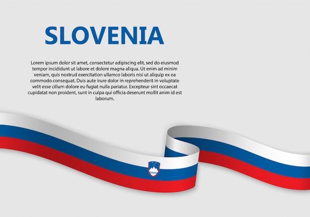 Agitant le drapeau de la slovénie