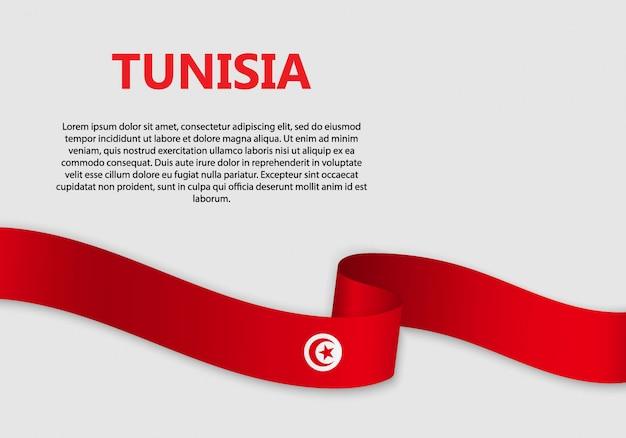 Agitant le drapeau de la tunisie