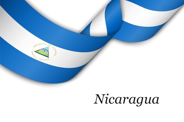 Agitant le ruban avec le drapeau du nicaragua.