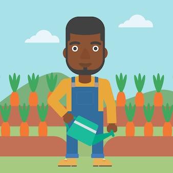 Agriculteur avec arrosoir
