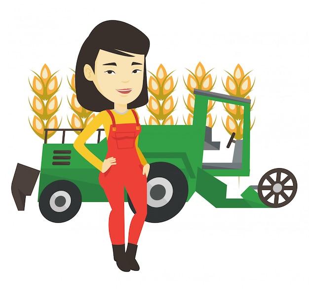 Agriculteur debout avec moissonneuse-batteuse sur fond.
