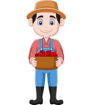 Agriculteur de dessin animé tenant un panier de pommes