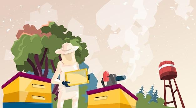 Un agriculteur recueille le miel de son rucher